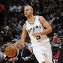 SAN ANTONIO - MARCH 25: Tony Parker #9 of the San Antonio Spurs handles the ball against the Oklahoma City Thunder at the AT&T Center on March 25, 2014 in San Antonio, Texas