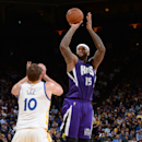 OAKLAND, CA - JANUARY 23: DeMarcus Cousins #15 of the Sacramento Kings takes a shot against the Golden State Warriors on January 23, 2015 at Oracle Arena in Oakland, California. (Photo by Noah Graham/NBAE via Getty Images)