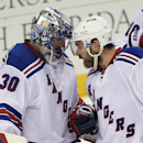 New York Rangers goalie Henrik Lundqvist (30), of Sweden, and defenseman Dan Boyle (22) congratulate each other after the Rangers defeated the Tampa Bay Lightning 5-1 in Game 4 of the Eastern Conference finals of the NHL hockey Stanley Cup playoffs, Friday, May 22, 2015, in Tampa, Fla. (AP Photo/Phelan M. Ebenhack)