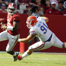 Alabama quarterback Blake Sims, left, scrambles for yardage around Florida defensive lineman Joey Ivie (91) during the first half of an NCAA college football game against on Saturday, Sept. 20, 2014, in Tuscaloosa, Ala. (AP Photo/Butch Dill)