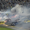Austin Dillon crashes into the fence on the final lap during a NASCAR Sprint Cup series auto race at Daytona International Speedway in Daytona Beach, Fla., Monday, July 6, 2015. (AP Photo/Phelan M. Ebenhack)