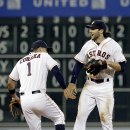 Houston Astros' Carlos Correa (1) and Jake Marisnick, right, celebrate their 6-3 win over the Los Angeles Angels in a baseball game Wednesday, July 29, 2015, in Houston. (AP Photo/Pat Sullivan)
