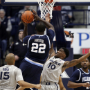 Feb 28, 2015; Cincinnati, OH, USA; Villanova Wildcats forward JayVaughn Pinkston (22) shoots during the first half against the Xavier Musketeers guard Remy Abell (10) at the Cintas Center. (Frank Victores-USA TODAY Sports)
