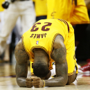 CLEVELAND, OH - MAY 24: LeBron James #23 of the Cleveland Cavaliers react after their 114 to 111 win over the Atlanta Hawks in overtime during Game Three of the Eastern Conference Finals of the 2015 NBA Playoffs at Quicken Loans Arena on May 24, 2015 in Cleveland, Ohio. (Photo by Gregory Shamus/Getty Images)