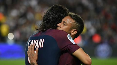 Pitch-invader aims kick at PSG star Kylian Mbappe