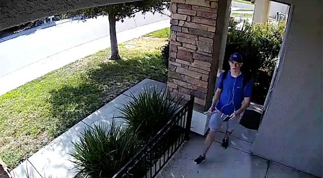 Surveillance video captures stranger returning wallet stuffed with $1500 in cash