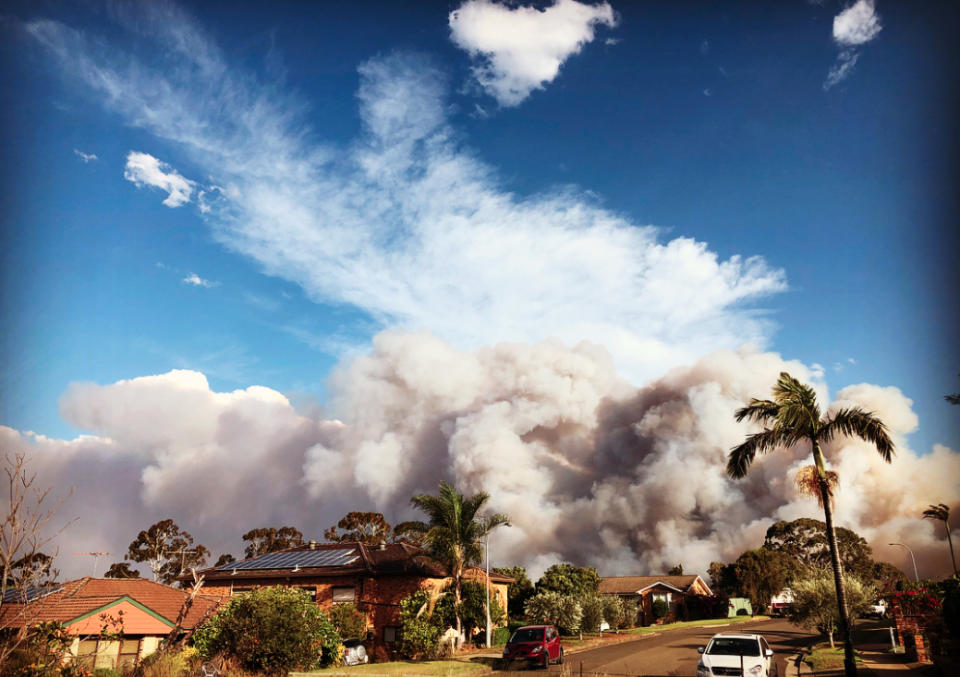 Huge smoke clouds rise above homes in Moorebank. Source Instagram  msclaire76