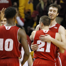 Wisconsin forward Frank Kaminsky hugs guard Josh Gasser (21) after Wisconsin defeated Minnesota 76-63 in an NCAA college basketball game in Minneapolis, Thursday, March 5, 2015. (AP Photo/Ann Heisenfelt)