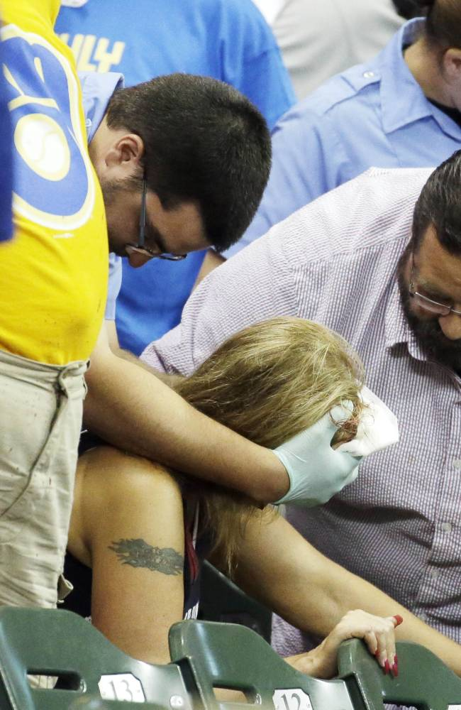 Fan hit by line drive and injured during Braves-Brewers game