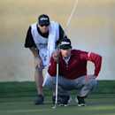 Jan 19, 2017; La Quinta, CA, USA; Dominic Bozzelli and his caddie David O'Donovan line up a putt on the 9th green during the first round of the CareerBuilder Challenge at PGA West Stadium Course. Mandatory Credit: Joe Camporeale-USA TODAY Sports