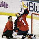 Florida Panthers goalie Roberto Luongo (1) talks to head athletic trainer Dave Zenobi, after an injury during the first period of an NHL hockey game, Tuesday, March 3, 2015, in Sunrise, Fla. Luongo did not play in the second period, but did in the third period. (AP Photo/Luis M. Alvarez)