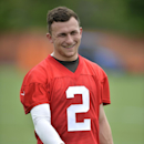 Cleveland Browns quarterback Johnny Manziel smiles during an NFL football organized team activity, Tuesday, May 26, 2015, in Berea, Ohio. (AP Photo/David Richard)
