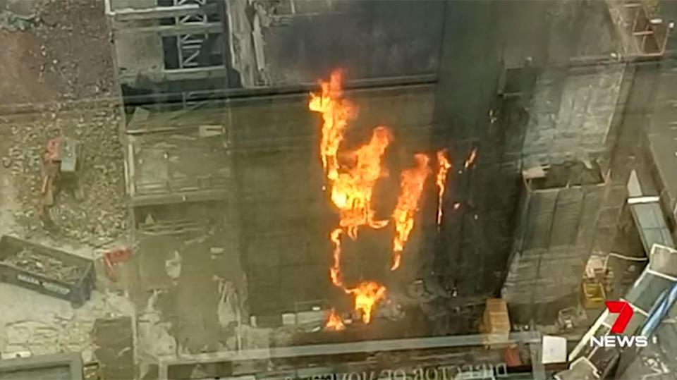 The mesh around the scaffolding was thought to be ignited by stray embers from a blow torch. Source 7 News