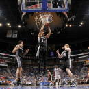 ORLANDO, FL - APRIL 1: Jeff Ayres #11 of the San Antonio Spurs grabs a rebound against the Orlando Magic on April 1, 2015 at Amway Center in Orlando, Florida. (Photo by Fernando Medina/NBAE via Getty Images