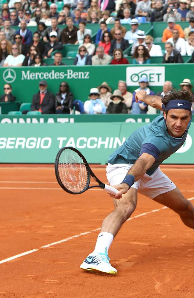 Roger Federer of Switzerland returns the ball to Novak Djokovic of Serbia, during their semifinal match of the Monte Carlo Tennis Masters tournament in Monaco, Saturday, April, 19, 2014. Federer won 7-6, 6-2