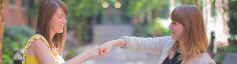 girl-fist-bump-header