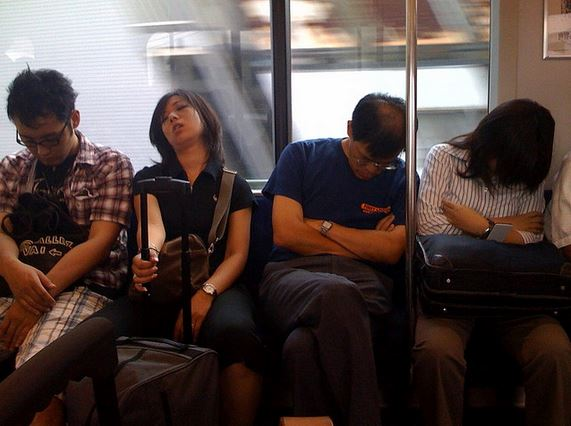 earning links is hard work and this photo shows four exhausted people on a busy subway line