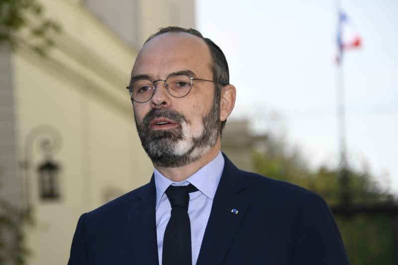 French Prime Minister Edouard Philippe speaks to the media at the Interministerial Crisis Coordination Unit outside the French Interior Ministry, as the spread of the coronavirus disease (COVID-19) continues, in Paris
