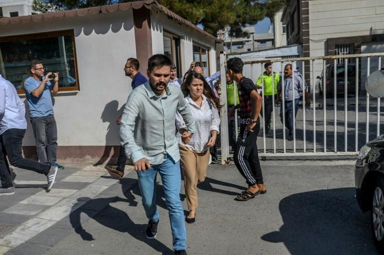 People sought cover in the Turkish border town of Akcakale after a mortar landed in the garden of a local government building