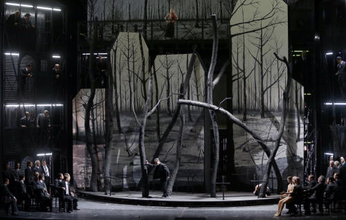 "In this picture taken Friday, June 21, 2013, Kwangchul Youn in the role of Ferrando, center, sings during a dress rehearsal for the opera ""Il Trovatore"" by Giuseppe Verdi in the Bavarian State Opera House in Munich, southern Germany. This wild new production by Olivier Py opened the company's annual Munich Opera Festival. It's a non-stop barrage of nightmarish images mixing styles and periods that assault the audience at lightning speed on a multi-tiered revolving set. (AP Photo/Matthias Schrader)"