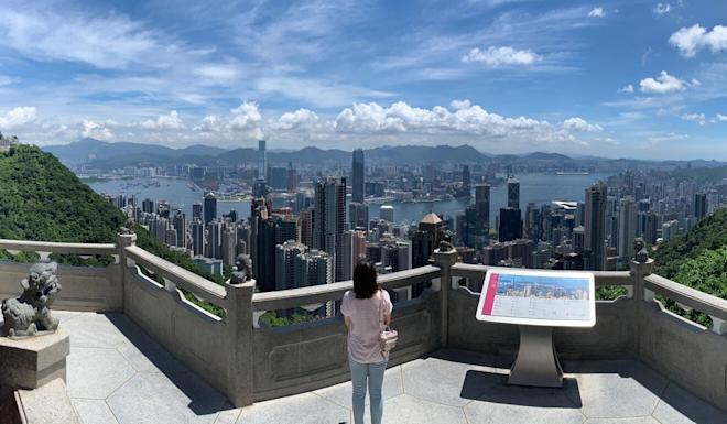 A woman looks out over the Hong Kong skyline from The Peak. Photo: Nora Tam