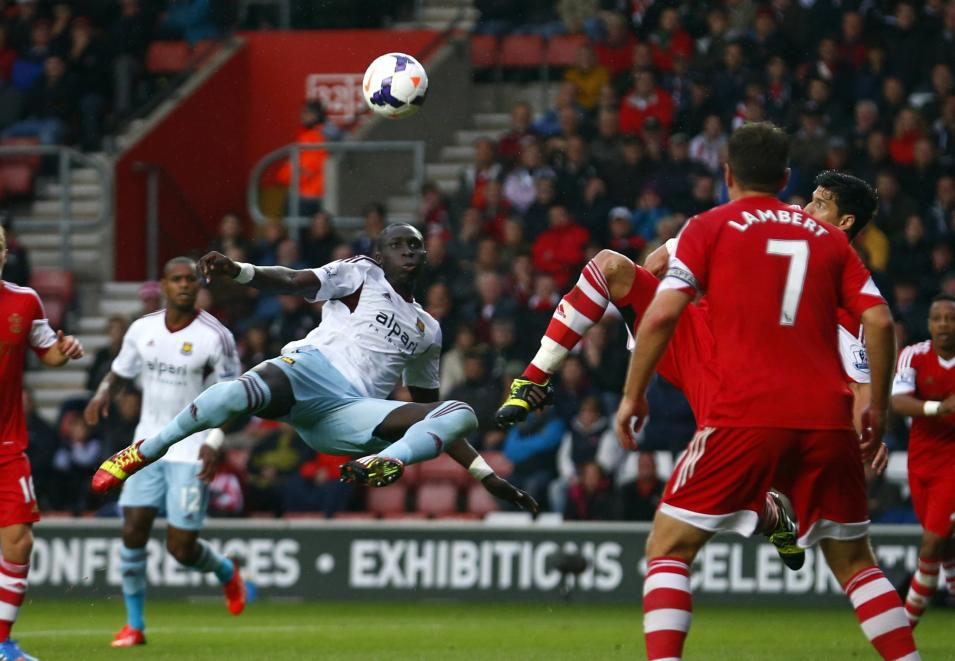 West Ham's Diame takes a shot on goal during their English Premier League soccer match against Southampton at St Mary's stadium in Southampton, southern England