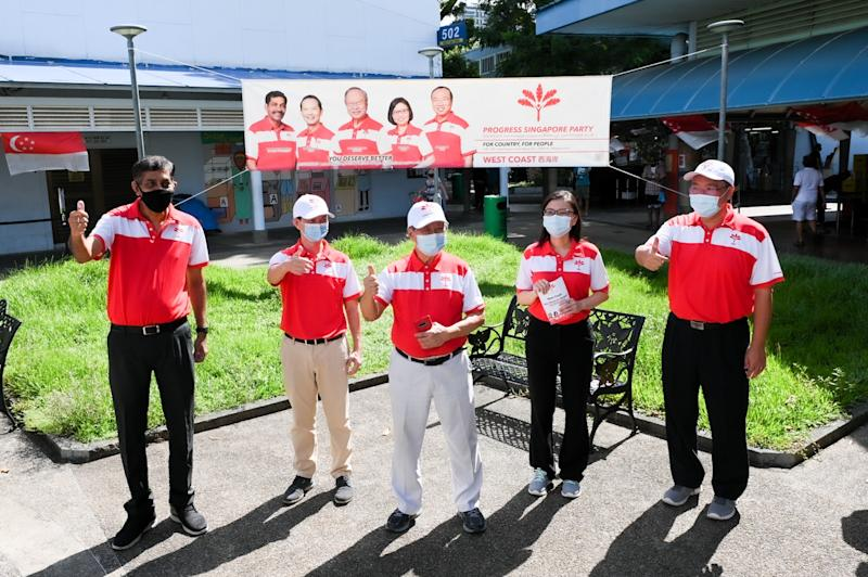 The Progress Singapore Party's West Coast GRC team at Ayer Rajah Market on Saturday (4 July). From left: Nadarajah Loganathan, Leong Mun Wai, Tan Cheng Bock, Hazel Poa, Jeffrey Khoo. (PHOTO: Joseph Nair for Yahoo News Singapore)