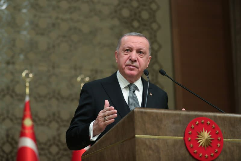 Turkish President Erdogan speaks during a symposium in Ankara