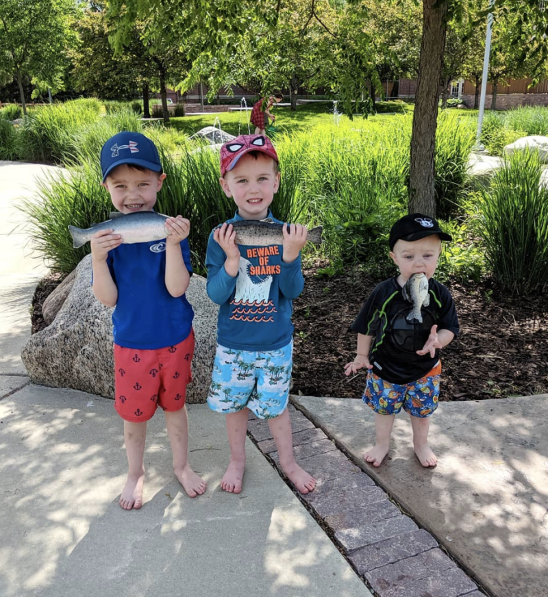 Levi, 4, Logan, 3 and Landon Daniels, 18 months, featured in the hilarious family photo during a trip to a museum in South Dakota.
