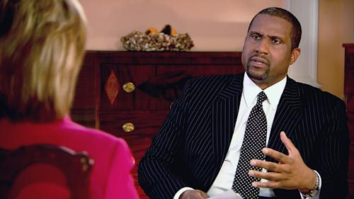 "This undated image from video released by PBS shows host Tavis Smiley, right, during an interview with Hillary Rodham Clinton on ""Tavis Smiley Reports."" Smiley, who's marking his 10th year this month as host of his PBS talk show and his 20th year in broadcasting. (AP Photo/PBS)"