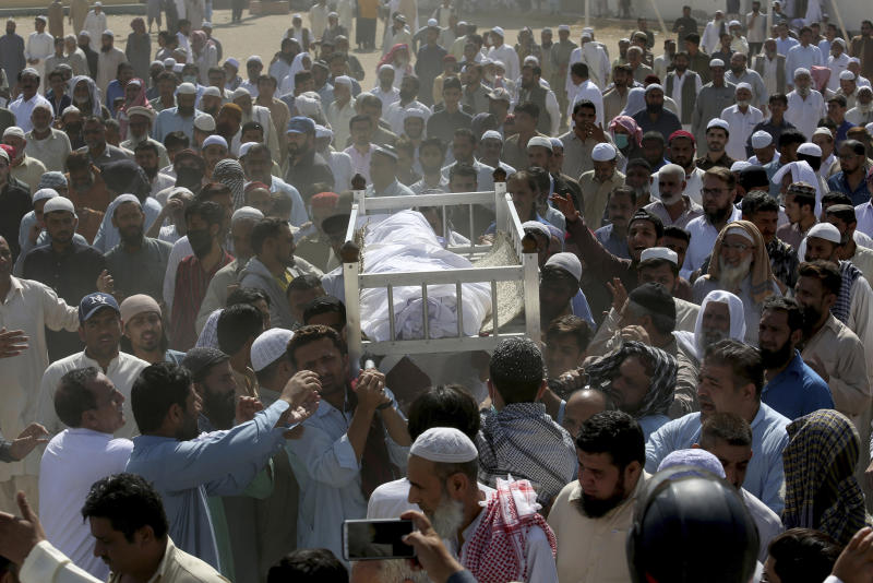 People carry the body of a victim of a toxic gas leak, during his funeral prayer, in Karachi, Pakistan, Monday, Feb. 17, 2020. The toxic gas leak killed several people and sickened dozens of others in a coastal residential area in Pakistan's port city of Karachi, police said Monday. The source of the leak, which occurred on Sunday night, and the type of gas that had leaked were not immediately known. There was no suspicion of sabotage. (AP Photo/Fareed Khan)