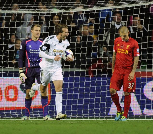 Swansea City's Michu celebrates scoring against Liverpool during their English Premier League soccer match in Swansea