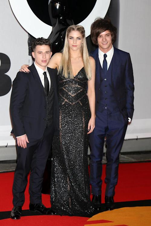 British trip-hop trio London Grammar, from left, Dan Rothman, Hannah Reid and Dot Major arrive at the BRIT Awards 2014 at the O2 Arena in London on Wednesday, Feb. 19, 2014. (Photo by Jon Furniss Photography/Invision/AP)