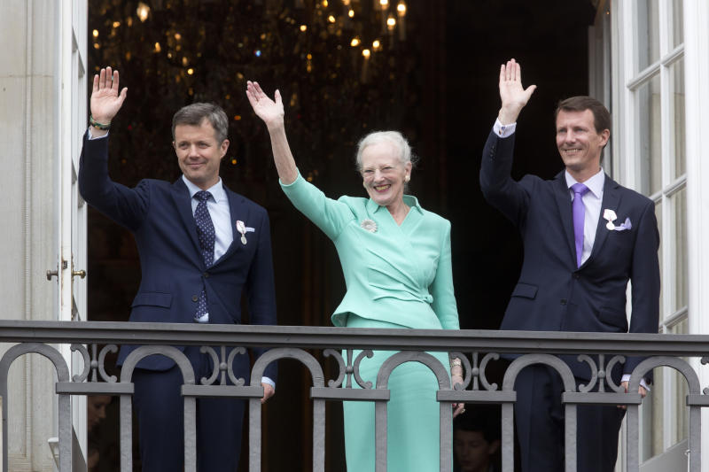 COPENHAGEN, DENMARK - APRIL 16: Queen Margrethe II of Denmark, and her sons Crown Prince Frederik of Denmark (L) and Prince Joachim of Denmark (R) appear on the Balcony of Amalienborg Palace on her 75th Birthday, on April 16, 2015 in Copenhagen, Denmark.(Photo by Julian Parker/UK Press via Getty Images)