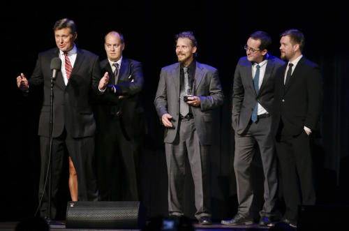 FILE - In this Sept. 27, 2012 file photo, the Gibson Brothers accept the entertainer of the year award at the International Bluegrass Music Association Awards show in Nashville, Tenn. The Gibson Brothers have won entertainer of the year for a second straight year at the International Bluegrass Music Awards Thursday, Sept. 26, 2013, as well as three other group and individual trophies. (AP Photo/Mark Humphrey, File)