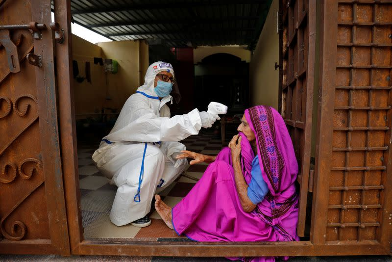 India's coronavirus cases jump by daily record of 97,894