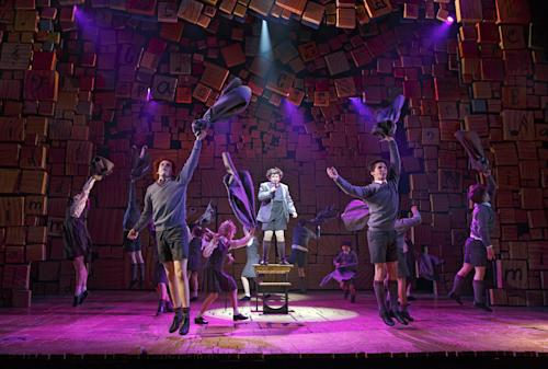 "This theater publicity image released by Boneau/Bryan-Brown shows the cast of ""Matilda The Musical,"" during a performance in New York. Great sets, choreography and songs make this British import hard to resist. Music and lyrics by Tim Minchin stick with you _ especially ""Miracle,"" ""Telly,"" ""When I Grow Up"" and ""The Smell of Rebellion"" _ and the whole show thrillingly reminds you of the darkness of being a kid. (AP Photo/Boneau/Bryan-Brown, Joan Marcus)"
