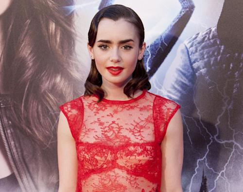 "FILE - In this Aug. 22, 2013 file photo, English actress Lily Collins attends the premiere of the film ""Cazadores de Sombras, Ciudad de Huesos"" (""The Mortal Instruments, City of Bones"") at Callao cinema in Madrid, Spain. If you're curious about Lily Collins and head to the Internet to find out, beware, McAfee has ranked the actress as the most dangerous celeb to search for online. (AP Photo/Abraham Caro Marin, File)"