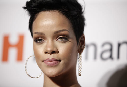 FILE - In this Feb. 7, 2009 file photo, Rihanna arrives at the Clive Davis pre-Grammy party in Beverly Hills, Calif. Two Los Angeles police officers won't face criminal charges alleging they leaked a photo of pop star Rihanna's bruised and beaten face after she was assaulted by singer Chris Brown, the Los Angeles County district attorney's office said. (AP Photo/Matt Sayles, File)
