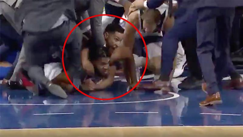 Ben Simmons had Karl-Anthony Towns wrapped up around the neck during the melee.