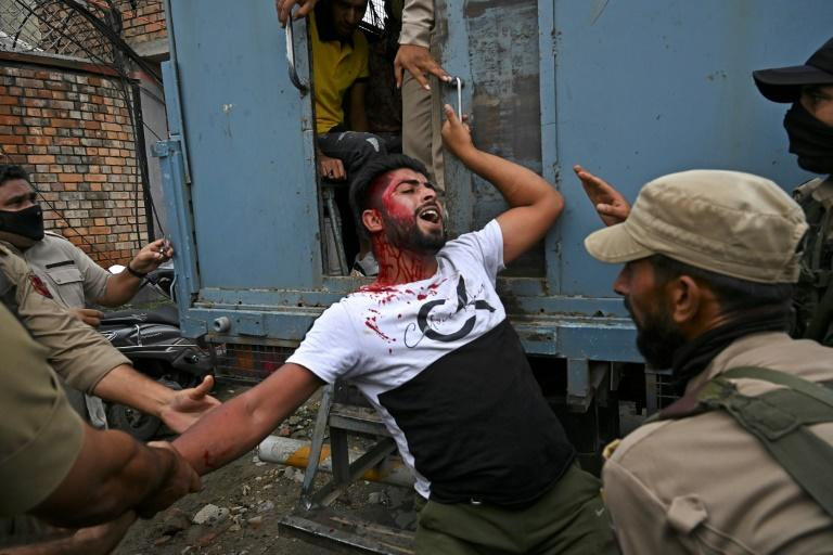 Indian forces clash with Kashmir Muslims marking holy month