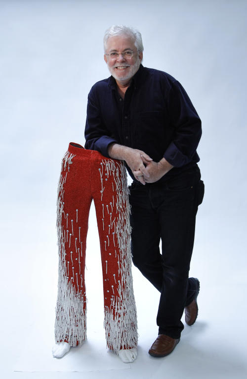 "In this image taken on Thursday, June 21, 2012, Michael Jackson's longtime costume and clothing designer, Michael Bush, poses for photos in Los Angeles. Bush tells the King of Pop's style secrets in a new photo-filled book, ""The King of Style: Dressing Michael Jackson"" to be released on Oct. 30, 2012. (AP Photo/Jae C. Hong)"