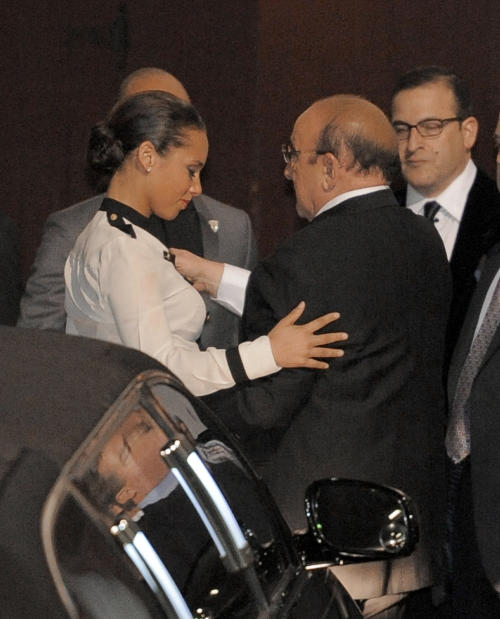 Alicia Keys, left, hugs Clive Davis at the loading dock outside the Beverly Hilton Hotel Saturday Feb. 11, 2012 in Beverly Hills Calif. Whitney Houston, who ruled as pop music's queen until her majestic voice and regal image were ravaged by drug use, erratic behavior and a tumultuous marriage to singer Bobby Brown, died Saturday. She was 48.(AP Photo/Mark J. Terrill)