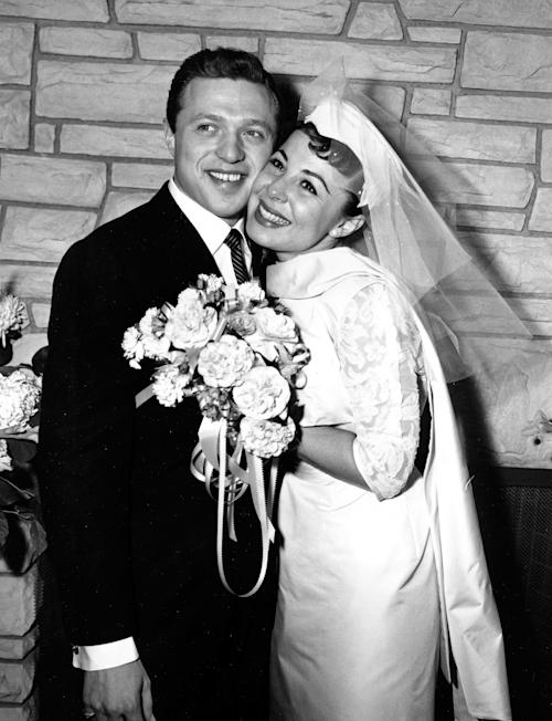 FILE - This Dec. 29, 1957 file photo, shows Eydie Gorme and Steve Lawrence, both 22, on their wedding day in Las Vegas. Gorme, a popular nightclub and television singer as a solo act and as a team with husband Steve Lawrence, has died. She was 84. Her publicist, Howard Bragman, says she died at a Las Vegas hospital Saturday, Aug. 10, 2013 following an undisclosed illness. (AP Photo/File)