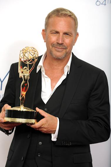 "Actor Kevin Costner, winner of the Emmy for outstanding lead actor in a miniseries or movie for ""Hatfields & McCoys,"" poses backstage at the 64th Primetime Emmy Awards at the Nokia Theatre on Sunday, Sept. 23, 2012, in Los Angeles. (Photo by Jordan Strauss/Invision/AP)"