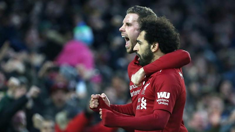Mohamed Salah (R) has fired Liverpool's winner to put them seven points clear at the top of the EPL
