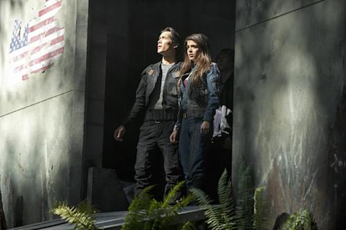"This publicity image released by The CW shows Bob Morley as Bellamy, left, and Marie Avgeropoulos as Octavia in the pilot episode of the new series ""The 100,"" premiering this fall on The CW. (AP Photo/ The CW, Cate Cameron)"