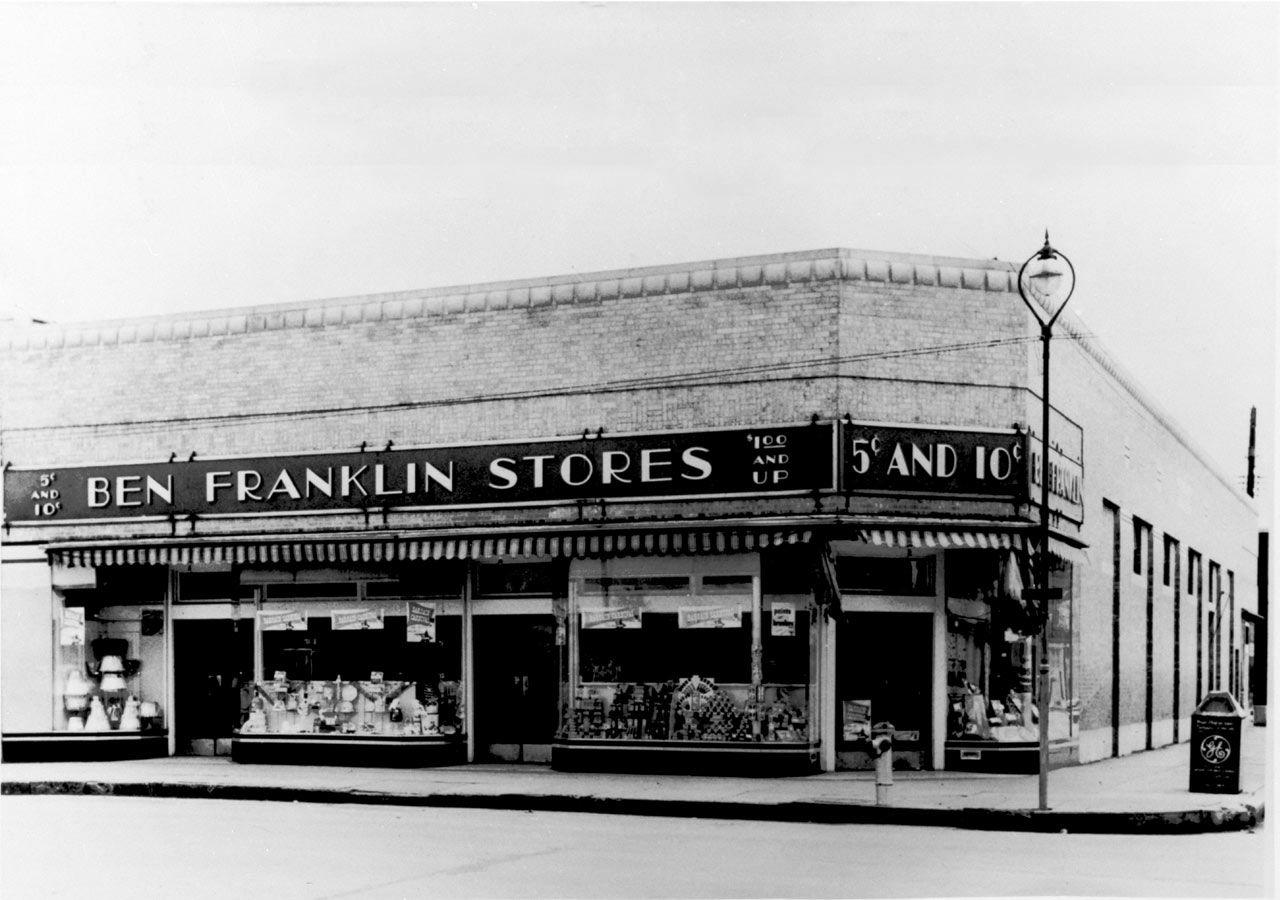 """<p>In 1945, Sam and Helen Walton purchased their first Ben Franklin """"variety store"""" in Newport, Arkansas. Within five years, Sam was able to make his Ben Franklin store the top franchise in the state. But when it came time for the couple to renew their lease, the landlord refused, so they were forced to look elsewhere.</p><p>Photo: Courtesy of The Walmart Museum</p>"""