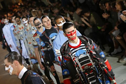 Model's present creations as part of the Givenchy men's fashion Spring-Summer 2014 collection, presented Friday, June 28, 2013 in Paris. (AP Photo/Francois Mori)