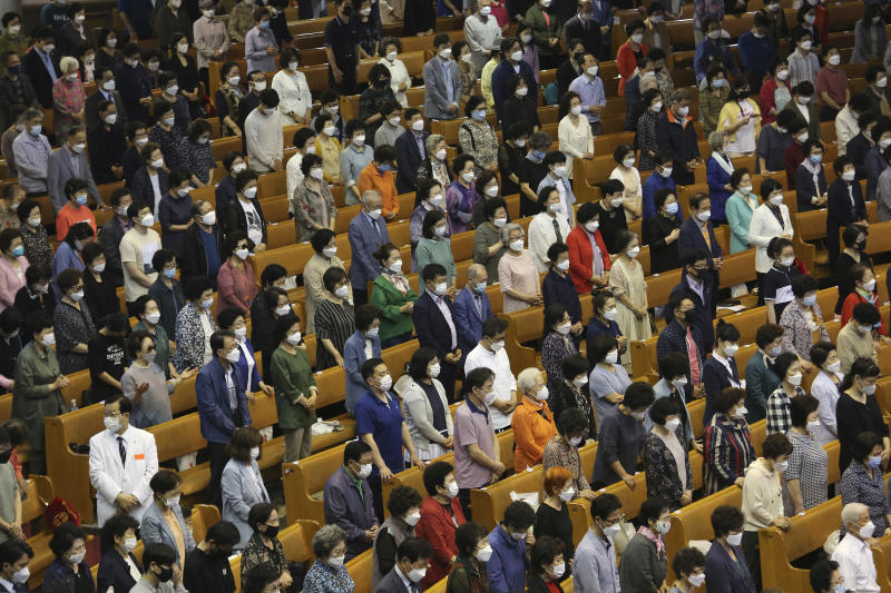 Christians wearing face masks to help protect against the spread of the new coronavirus pray during a service at the Yoido Full Gospel Church in Seoul, South Korea, Sunday, May 31, 2020. (AP Photo/Ahn Young-joon)
